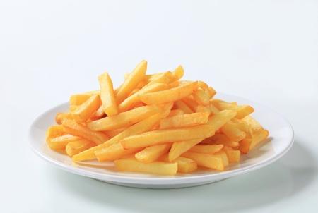 papas fritas: Porci�n de papas fritas en un plato