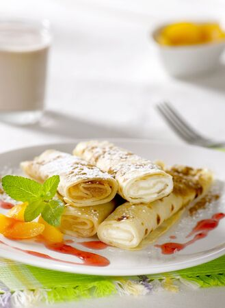 filled roll: Rolled up crepes filled with sweet fillings  Stock Photo