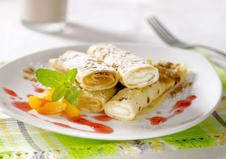 fillings: Rolled up crepes filled with sweet fillings  Stock Photo