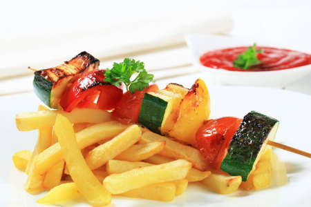 Dish of vegetable skewer and French fries Stock Photo - 12578977