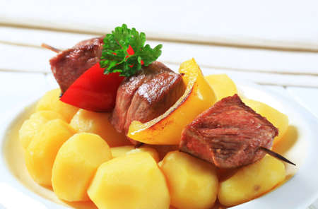 Chunks of grilled meat on skewer with potatoes Stock Photo - 12578957