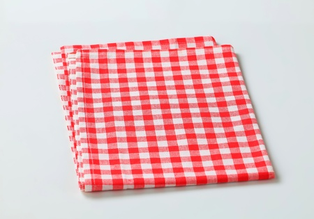 Red and white checked table linen photo