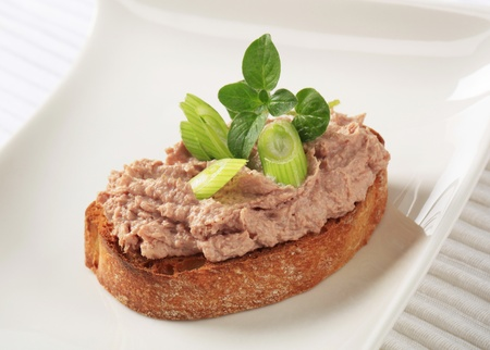 pate: Slice of toasted bread and liver pate Stock Photo