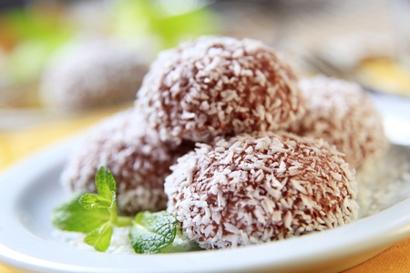 Chocolate  and coconut confections filled with cream photo
