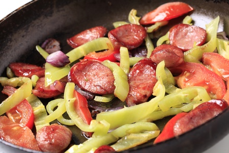 Preparing sausage and vegetable stir fry - detail photo