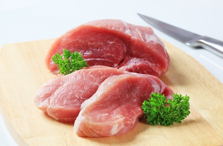 Fresh pork meat on a cutting board Stock Photo