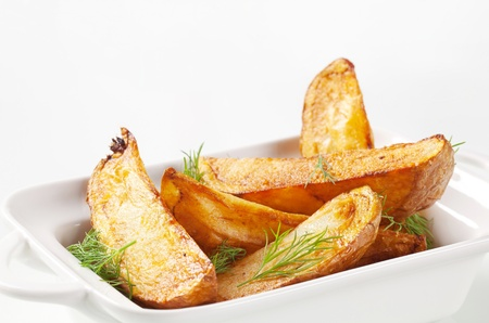fried potatoes: Roasted potato wedges garnished with fresh dill