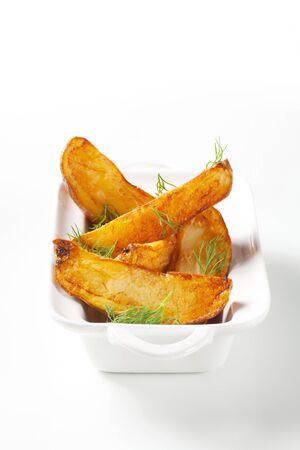 potato wedges: Roasted potato wedges garnished with fresh dill