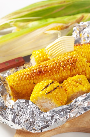 sweet corn: Pieces of sweet corn grilled in tin foil