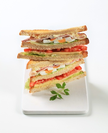 Deli sandwiches with ham, cheese, egg and veggies photo