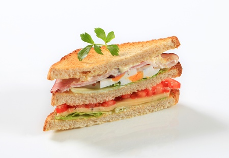 ham and cheese: Deli sandwich with ham, cheese, egg and veggies Stock Photo