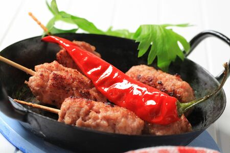 Minced meat kebabs on wooden sticks Stock Photo - 13236910