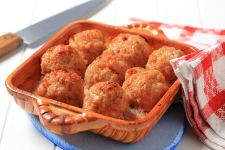 Balls of minced meat baked with cheese photo