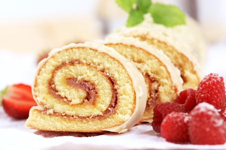 swiss roll: Detail of Swiss roll and fresh raspberries Stock Photo