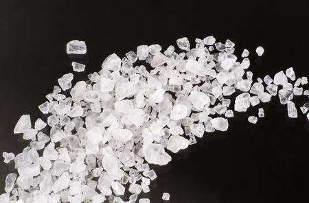 crystal background: Detail of sea salt crystals on black background
