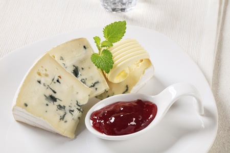 Wedges of blue cheese and  fruit preserve photo