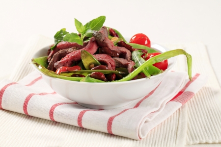 Vegetable salad with strips of roast beef photo