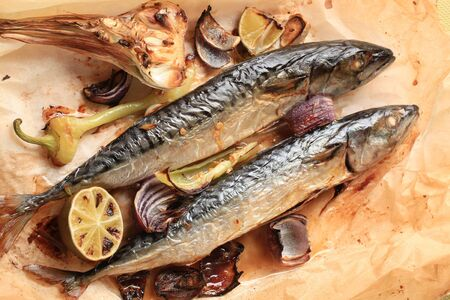 Baked mackerel and vegetables on baking paper photo