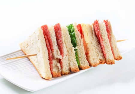 Multi-layered sandwich with thin sliced salami photo