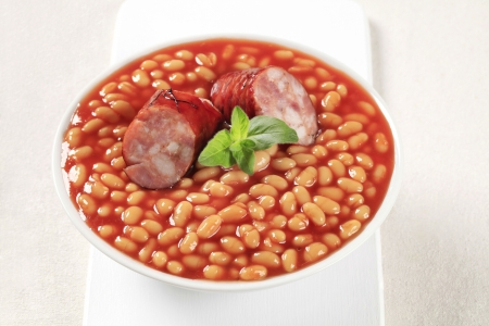 Baked beans and sausage in a white bowl  photo