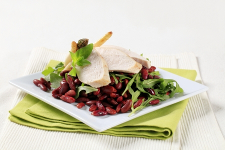 Slices of chicken breast with red beans and arugula Stock Photo - 13903485