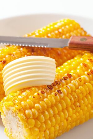 Roasted corn on the cob with butter photo