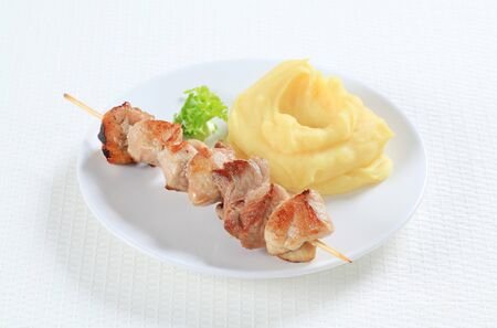 Grilled pork skewer with mashed potato photo