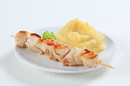 Chicken skewer with mashed potato photo