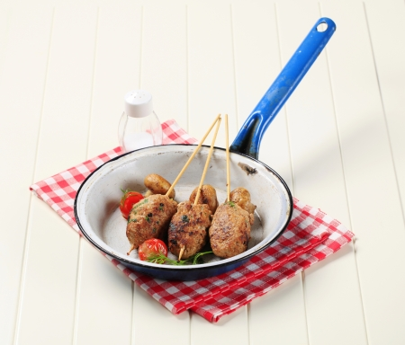 Minced meat kebabs and pan roasted mushrooms  photo