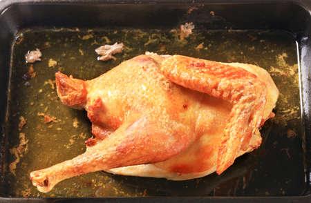 Pollo asado en una bandeja para hornear Foto de archivo - 14258860