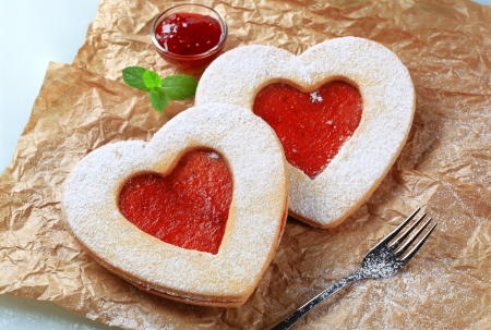 Heart shaped shortbread cookies with jam filling photo