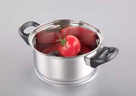 Stainless steel pot with a tomato in it photo