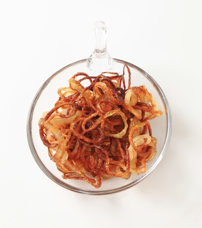 browned: Dish of browned onion - studio shot Stock Photo