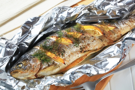 trout: Oven baked trout stuffed with lemon and dill