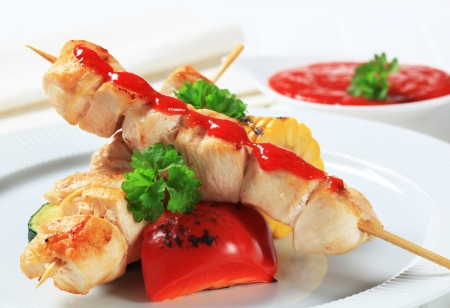 Chicken skewers with vegetables and dipping sauce photo