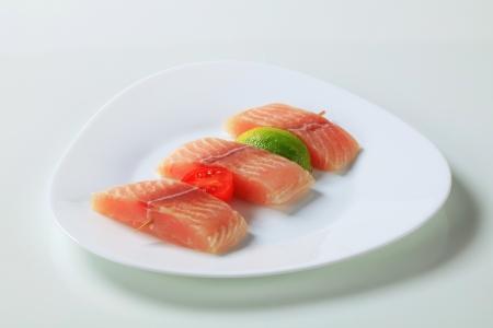 alaska pollock: Raw fish skewer on a plate