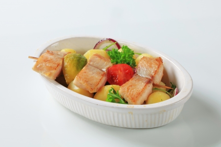 Fish skewer and potatoes in casserole dish Stock Photo - 14548491