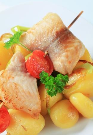 alaska pollock: Fish skewer and potatoes - detail