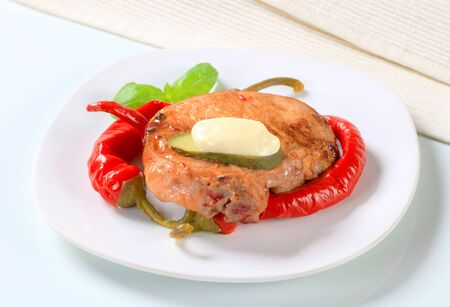 Pan-fried pork chop with pickled chili peppers photo