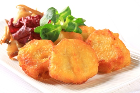Chicken nuggets with sauteed oyster mushrooms photo