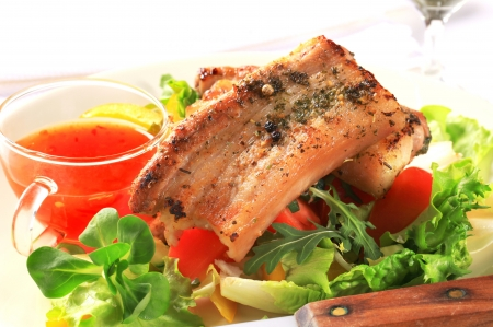 Pan fried pork belly rubbed with herbs photo