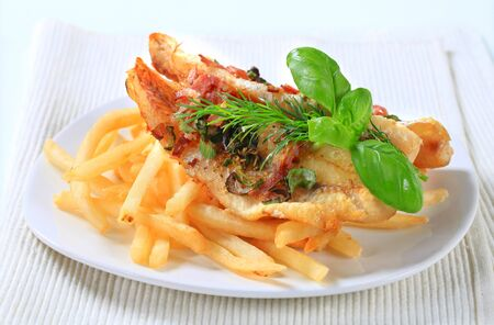 Pan fried fish fillets with French fries photo