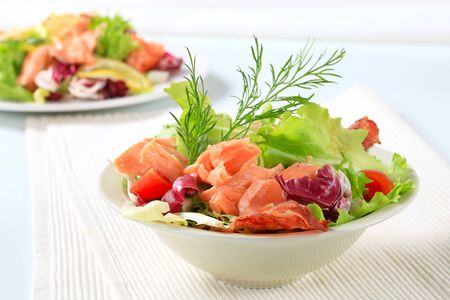 Bowl of green salad with salmon  photo