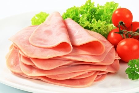 Stack of thinly sliced ham photo