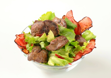 Chicken liver salad with crispy bacon strips photo