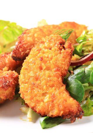 greens: Crispy chicken tenders with salad greens