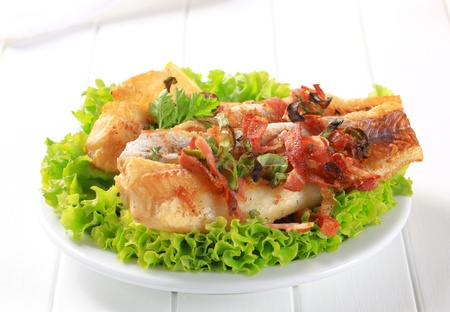 Pan fried fish fillets sprinkled with crispy bacon bits Stock Photo - 15183874