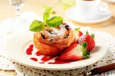 Pain au raisin with fresh strawberries photo