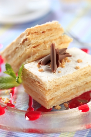 Mille-feuille pastry dusted with powdered sugar photo