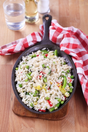 Vegetable fried rice on a frying pan photo